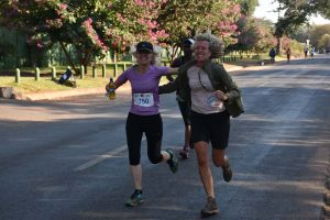 Mo giving Anne-Marie some dodgy stuff to drink (urine?) and running a few metres with her