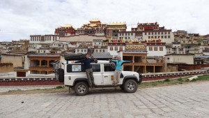 Lara in front of a Tibetan Monastery.