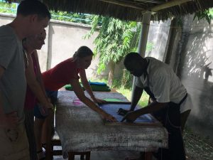 Katia, the wonder woman who started all this, is checking a new design for a large lizard with Mr Cloudy, the print-screen expert and only man working at the centre