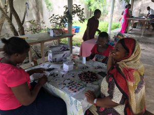 this is additional income for the ladies, they make the little dolls (mabinti) at home and all proceeds go to them. For a large order many work on it in the evening hours, including previous graduates from Mabinti