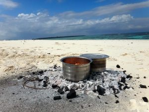 lunch is being prepared on the beach