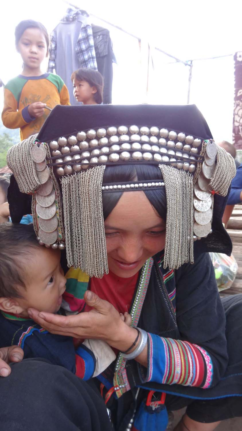 typical headdress and clothes for an Akha woman