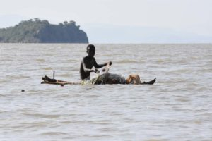 a fisherman on Lake Baringo pulling in his net