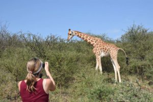 Jude trying to get even closer to the giraffes in the Ruko Conservancy