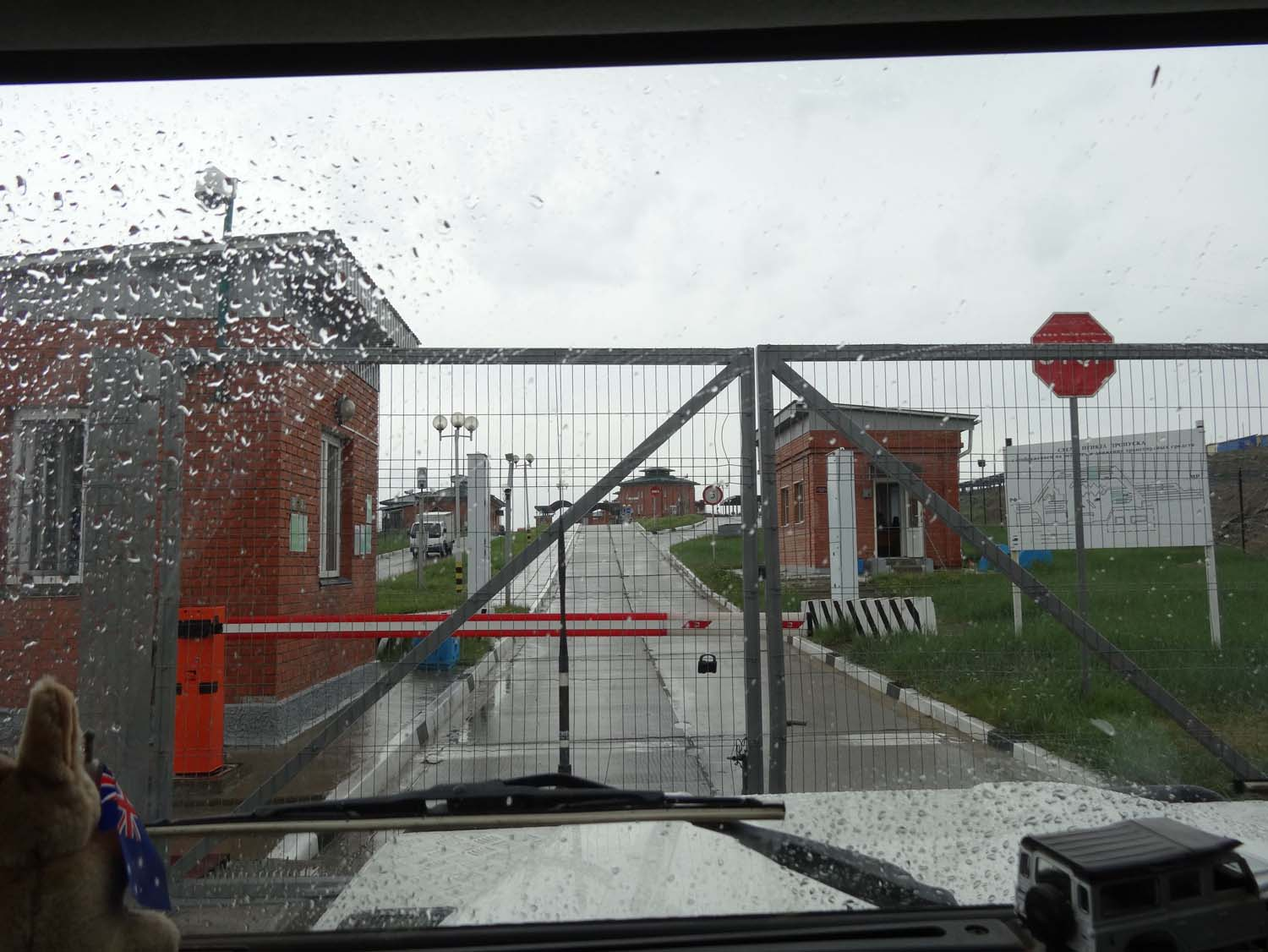 a closed gate at the Russian border, a few minutes later it is opened