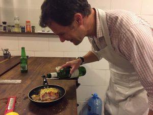 Jon adding a bit of wine to Jude's fish with prawns stack