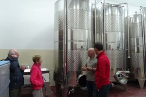 Ian, Bernice and Jon listening to the owner at Stilianou explaining the olive oil process