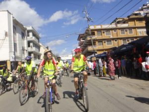 Barbara and Jude riding through the potholed streets of downtown Dar es Salaam