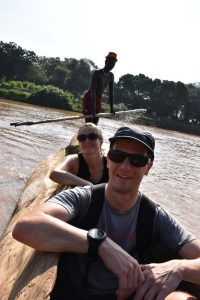 crossing the Omo River in a dugout canoe to reach the Dasenech village