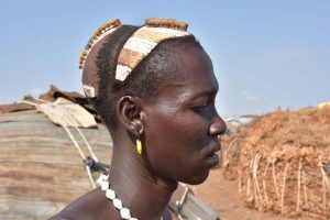 a man from the Dasenech tribe shows off his hairdo