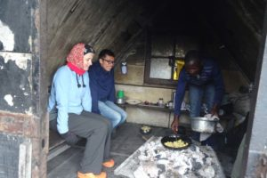 when there is no visibility we shelter to stay warm in one of the kitchens next to the open cooking fire
