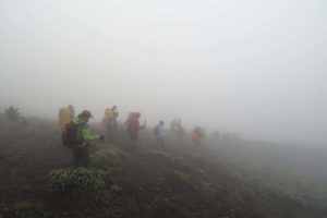 heading down Nyiragongo in the early morning mist