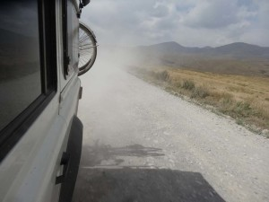 Lara creating a dust cloud on the way to Son Kul in Kyrgyzstan.