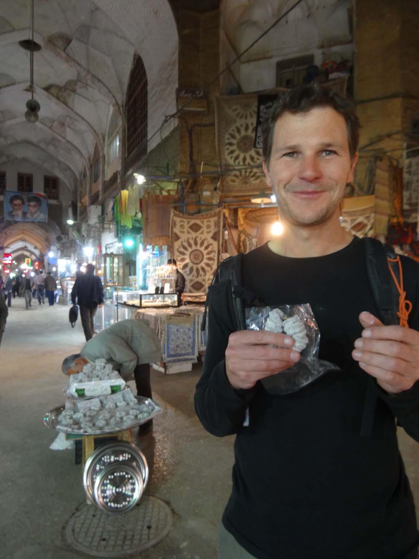 trying some local delicacies in the bazaar of Esfehan