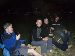 enjoying a few drinks around the campfire