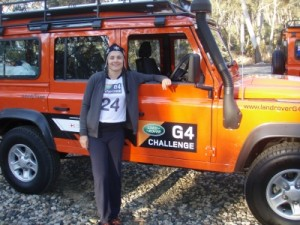 Jude next to the beautiful orange G4 Land Rover Defender