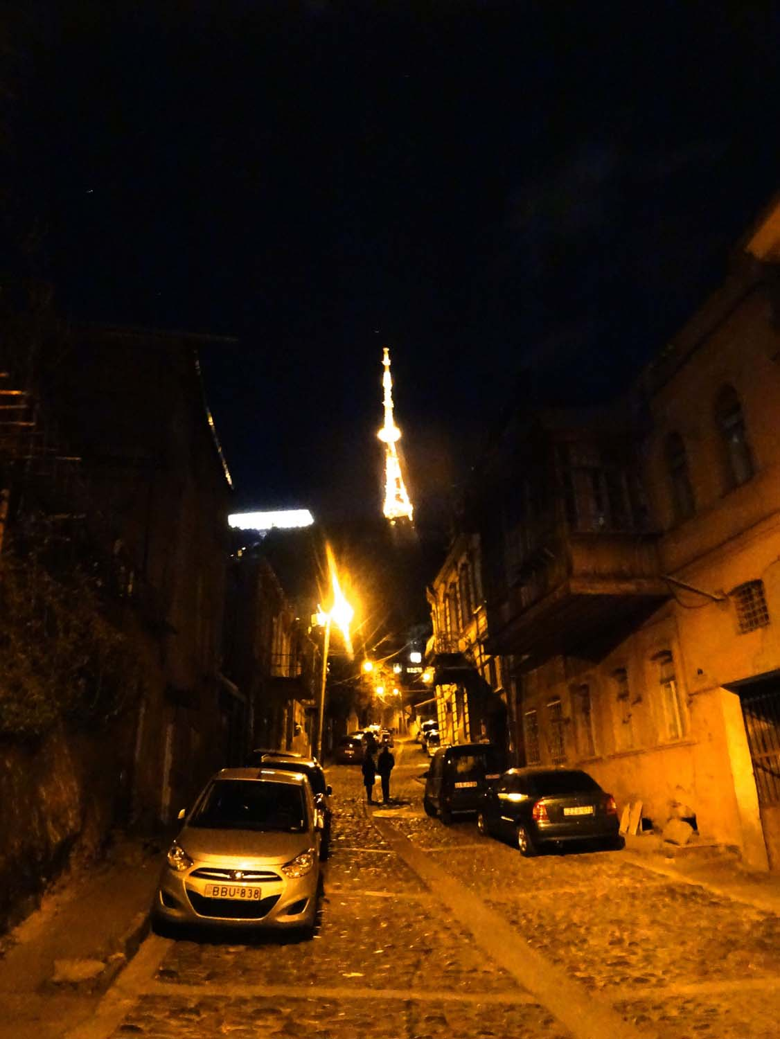 Tim and Martina walking through the ancient streets of Tbilisi on their way home