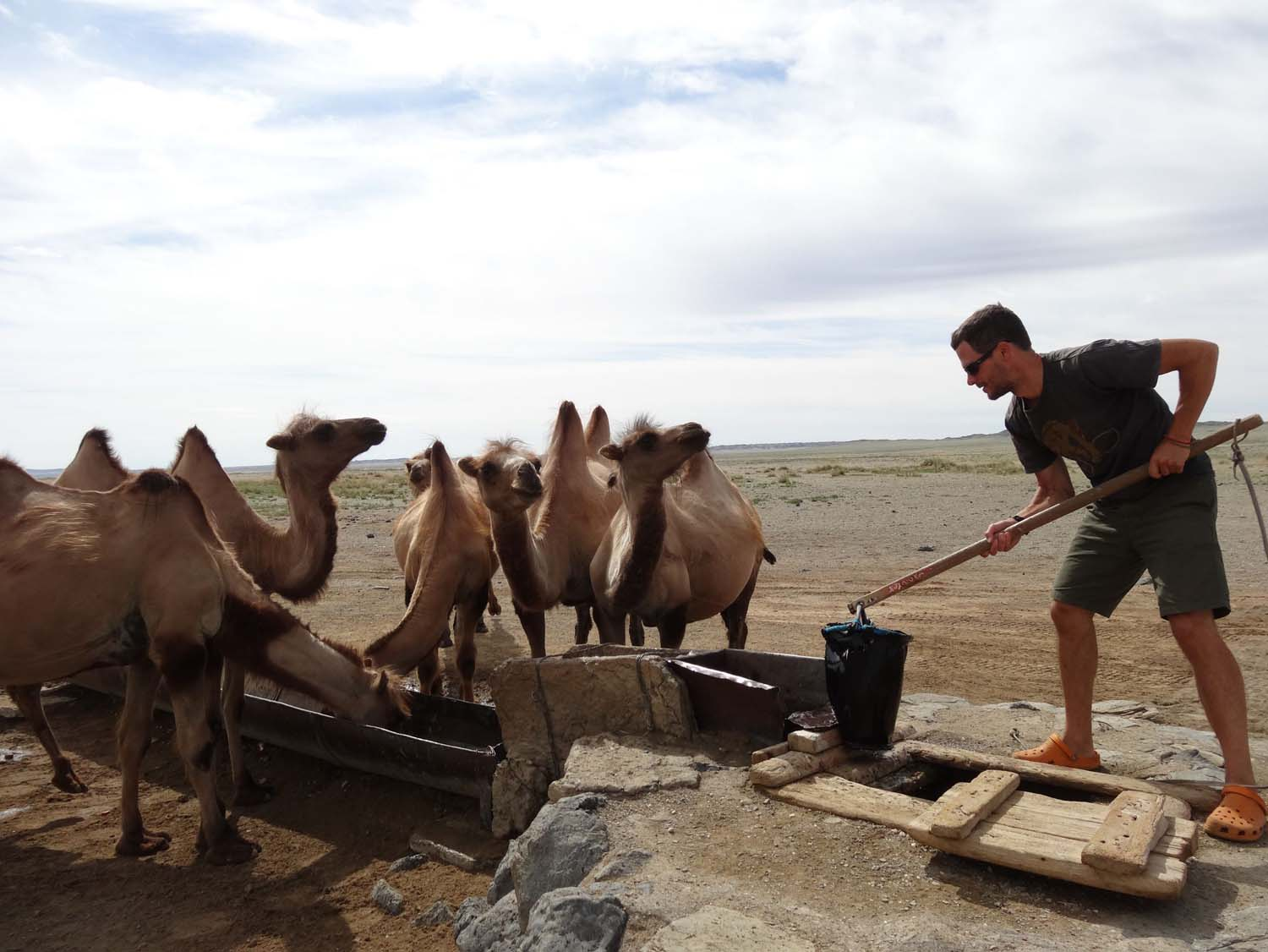 Jon using the well to give the camels a drink