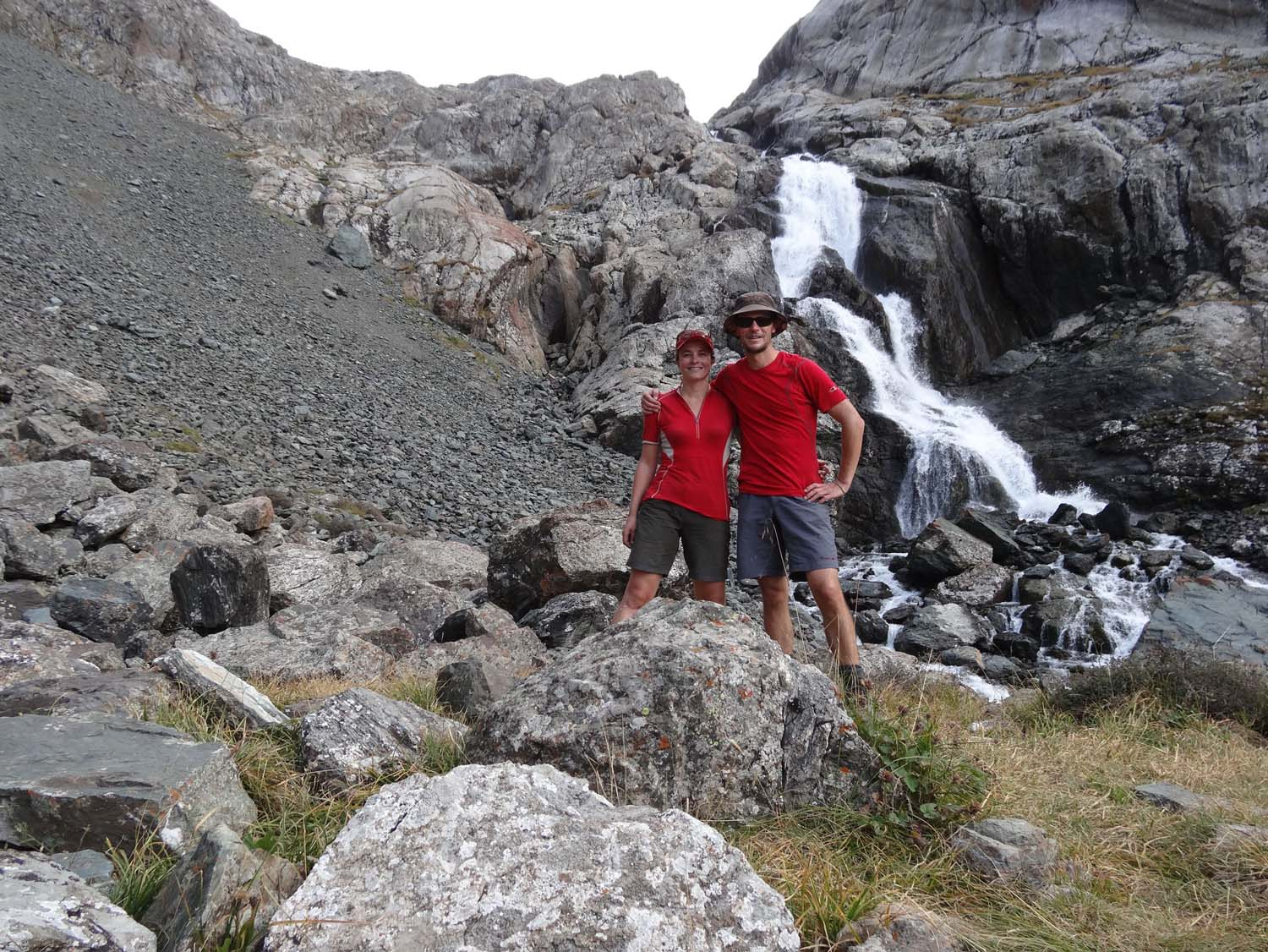 this waterfall comes directly from the beautiful lake, we just have to get up that scree slope behind us to get there