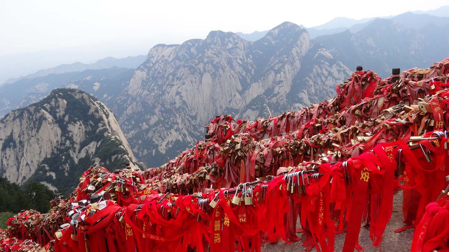 lots of couples leave a padlock with their names engraved in it on the mountain, often together with a red piece of cloth for good luck