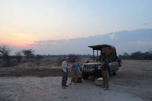 Jude and Esther having a sundowner with our excellent guide Leonard