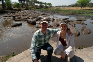 Jon and Jude in front of a bloat of hippos, all precariously living closely together as the river has pretty much dried up