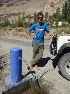 Filling up the water tanks of Lara by the side of the road in Tajikistan near the Khaakha Fortress, using a pump the locals use to fetch water for their houses
