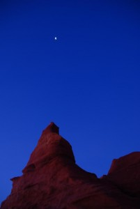 the moon above the red rocks at Cape Leveque