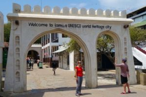 Jude has arrived at the Lamu Unesco sign in town