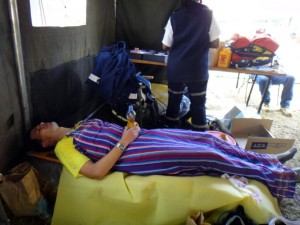 Jon recovering in the medical tent, drinking ORS