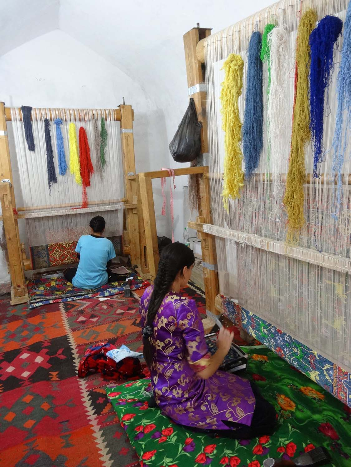 weaving with naturally dyed silk, it takes 6 months to finish one carpet
