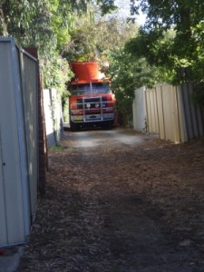 the moving truck arrives in the back lane