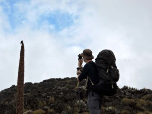 Jon taking a picture of a mountain chat