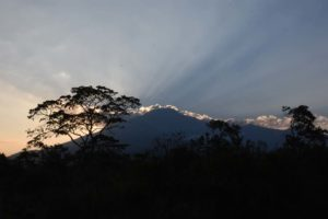 we finish the day with sunset behind Mt Meru, after starting it with seeing the sun rise behind Kilimanjaro that same morning and summiting Mt Meru - what a day!
