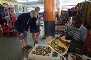 looking at paintings at the Maasai Market