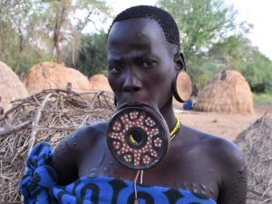 a Mursi lady showing her lip plate
