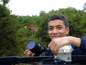 Jessie taking lots of photos, also of the giraffe behind him