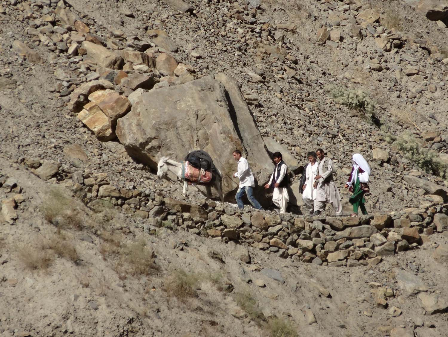 Afghans walking on the amazing trail, often hacked out in the rocks