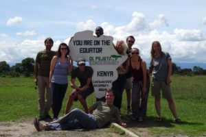 the crew minus Marcel and Katharina at the equator sign: Hafiz, Eva, James, Hervé (behind the sign), Jon (on the ground), Anne-Marie, Gerald, Jude and Helen