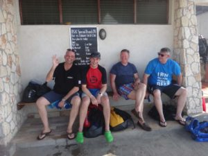 Cor, Jon, Kevin and Ryan on the bench at the dive section's storage shed after a skills session in the bay