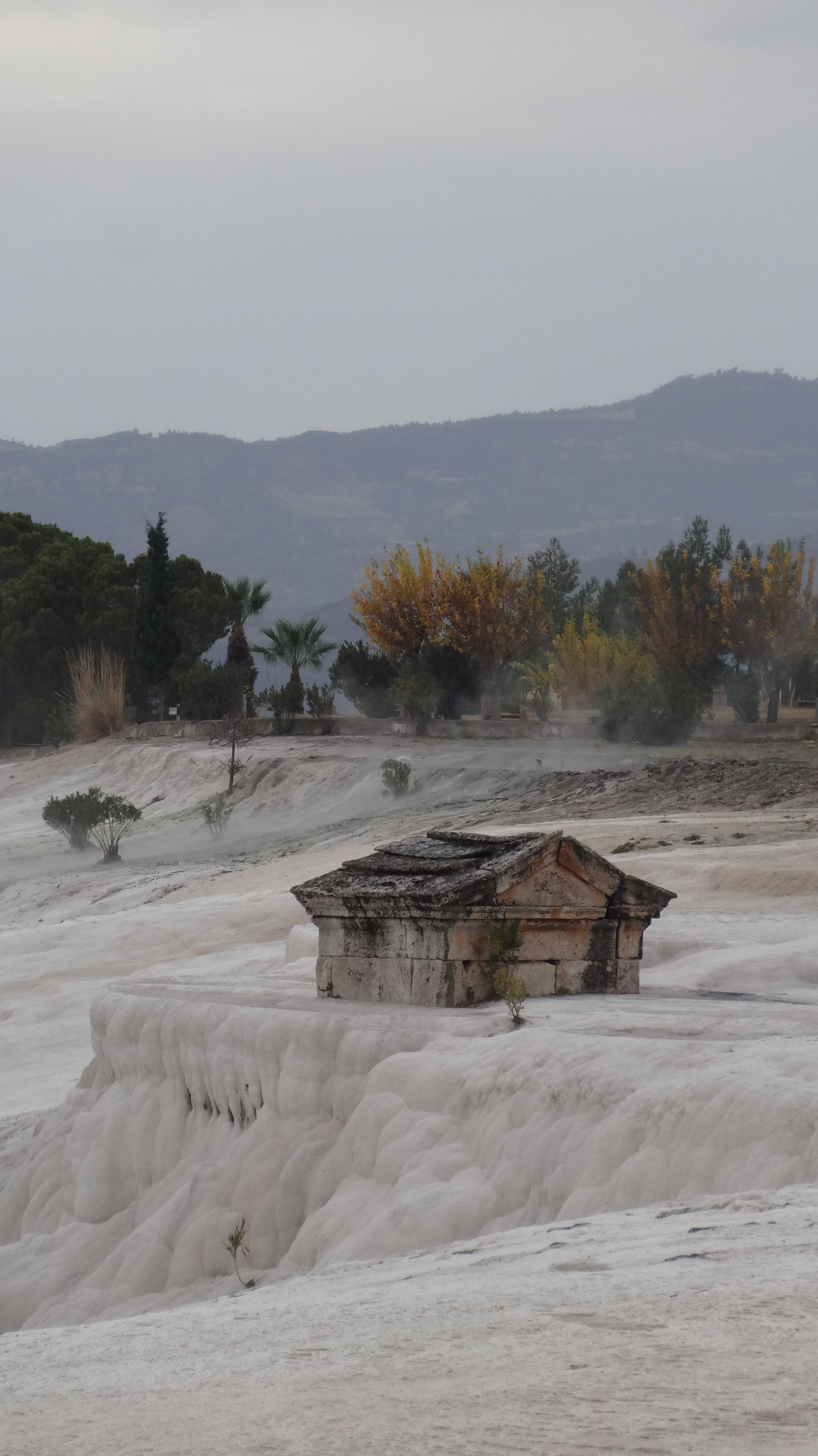 Roman ruins being slowly engulfed by the travertines at Pamukkale