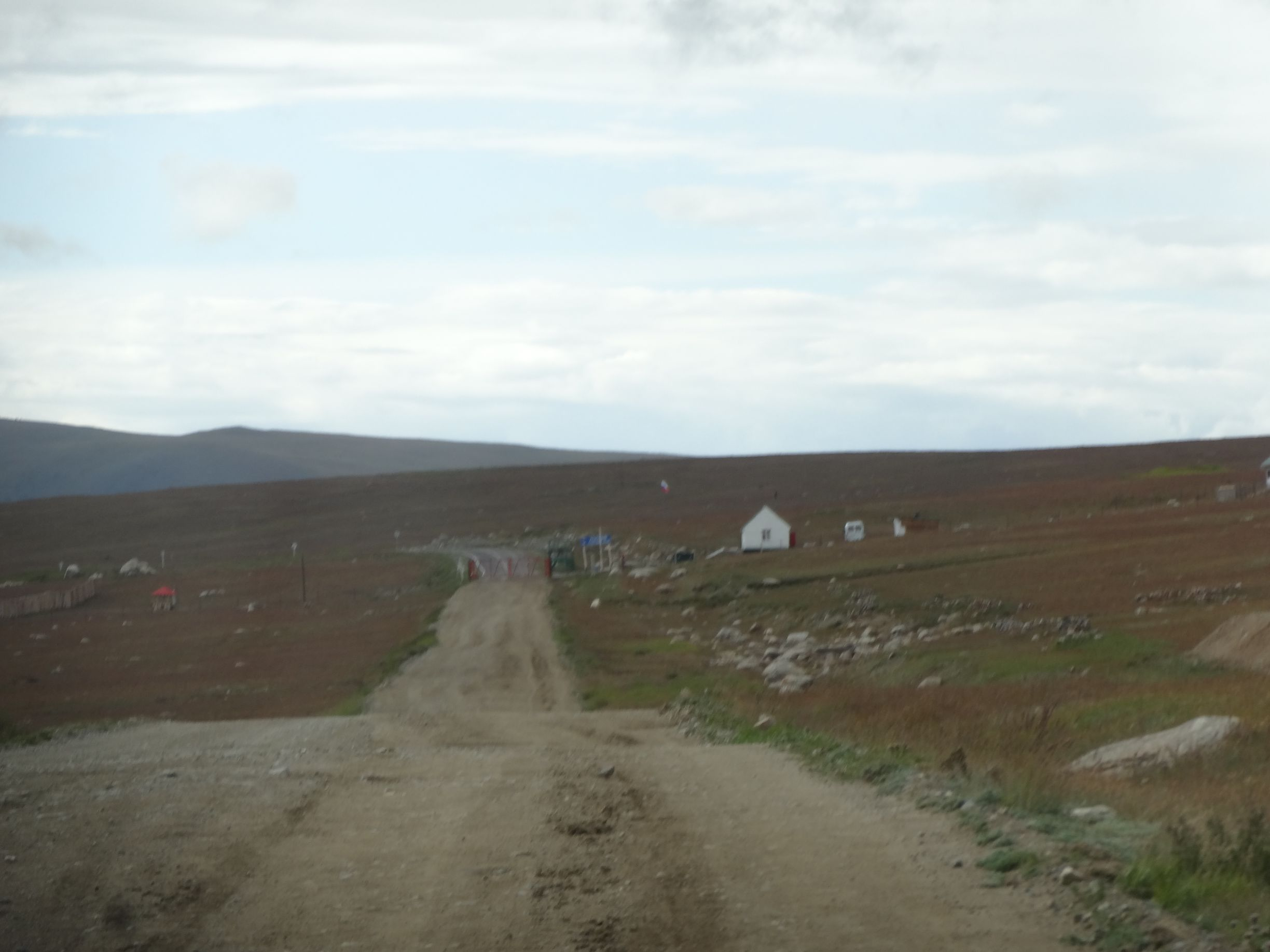 the actual border, there is only a gate and gatehouse, the Russian checks are done several km further down the tarmac road