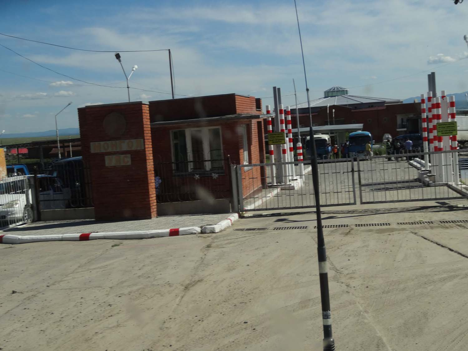 entry to Mongolia, the disinfectant dip is just to the right of those white - red poles