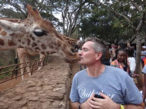 Dave giving the giraffe a kiss