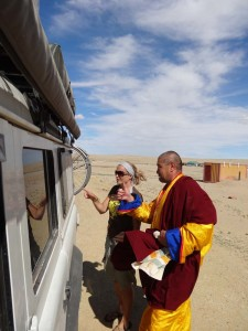 Explaining our trip to a monk in Sainshand, Mongolia.