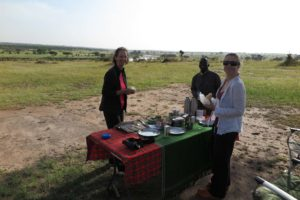 Regine, Said and Jude having breakfast in the Serengeti