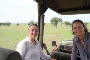Jude and Regine in the safari car, watching the two cheetah brothers walk past