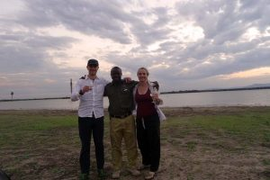 Jon, Alfred and Jude enjoying sundowners at one of Selous' many lakes