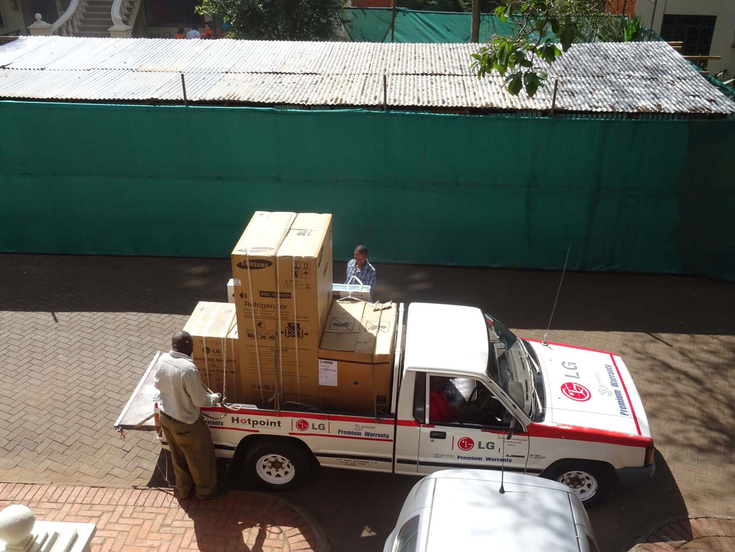 taking delivery of our fridge, stove and washing machine - a Kenyan house does not come with a stove...