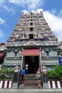 Jude at the entrance to the Sri Navasakthi Vinayagar Hindu Temple in Victoria (on Mahé island)